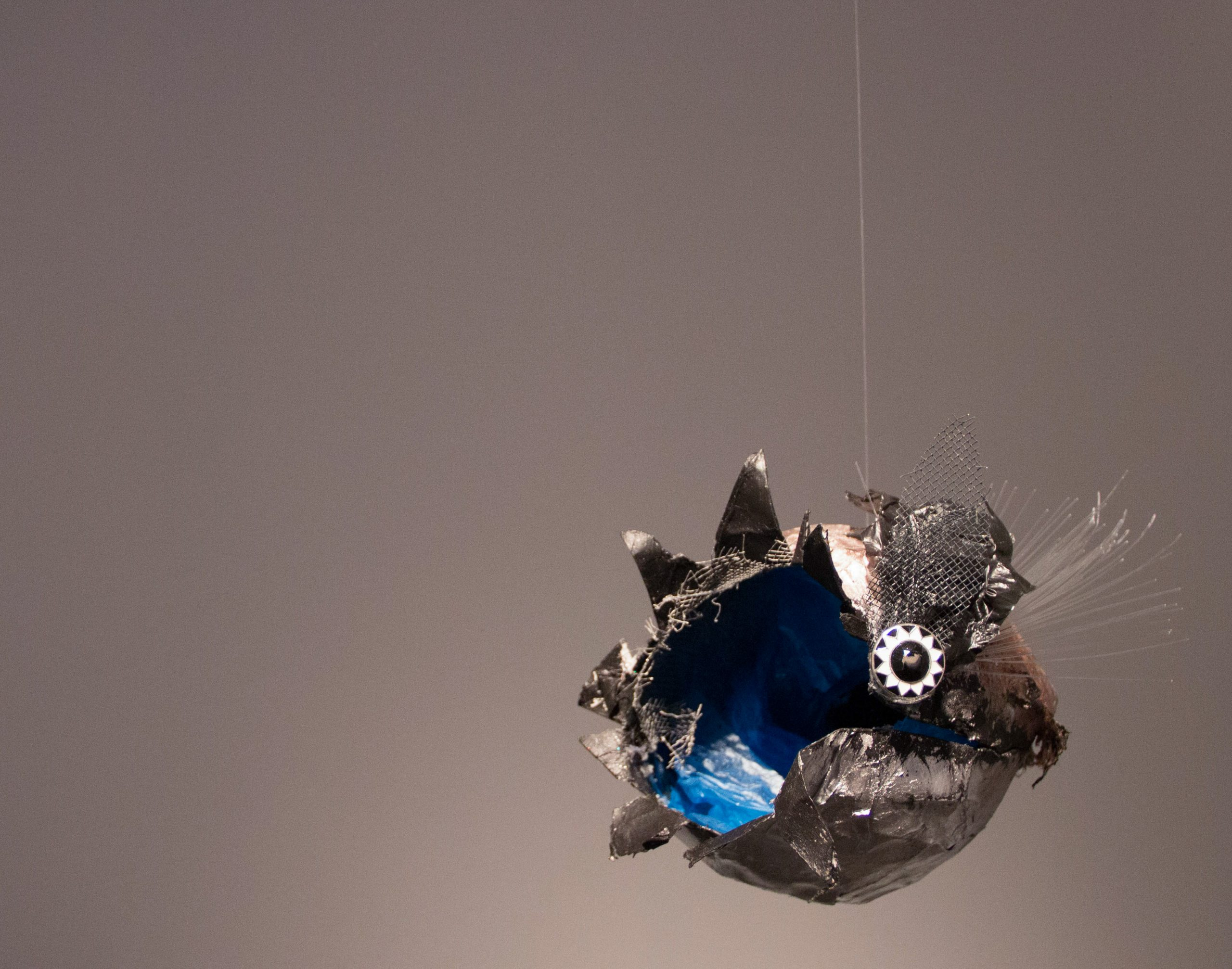 """thingamabob #2, 2014. Paper, plastic bags, wire, button, monofilament, wire mesh, spray paint, acrylic paint. Approx. 7"""" x 8"""" x 6."""