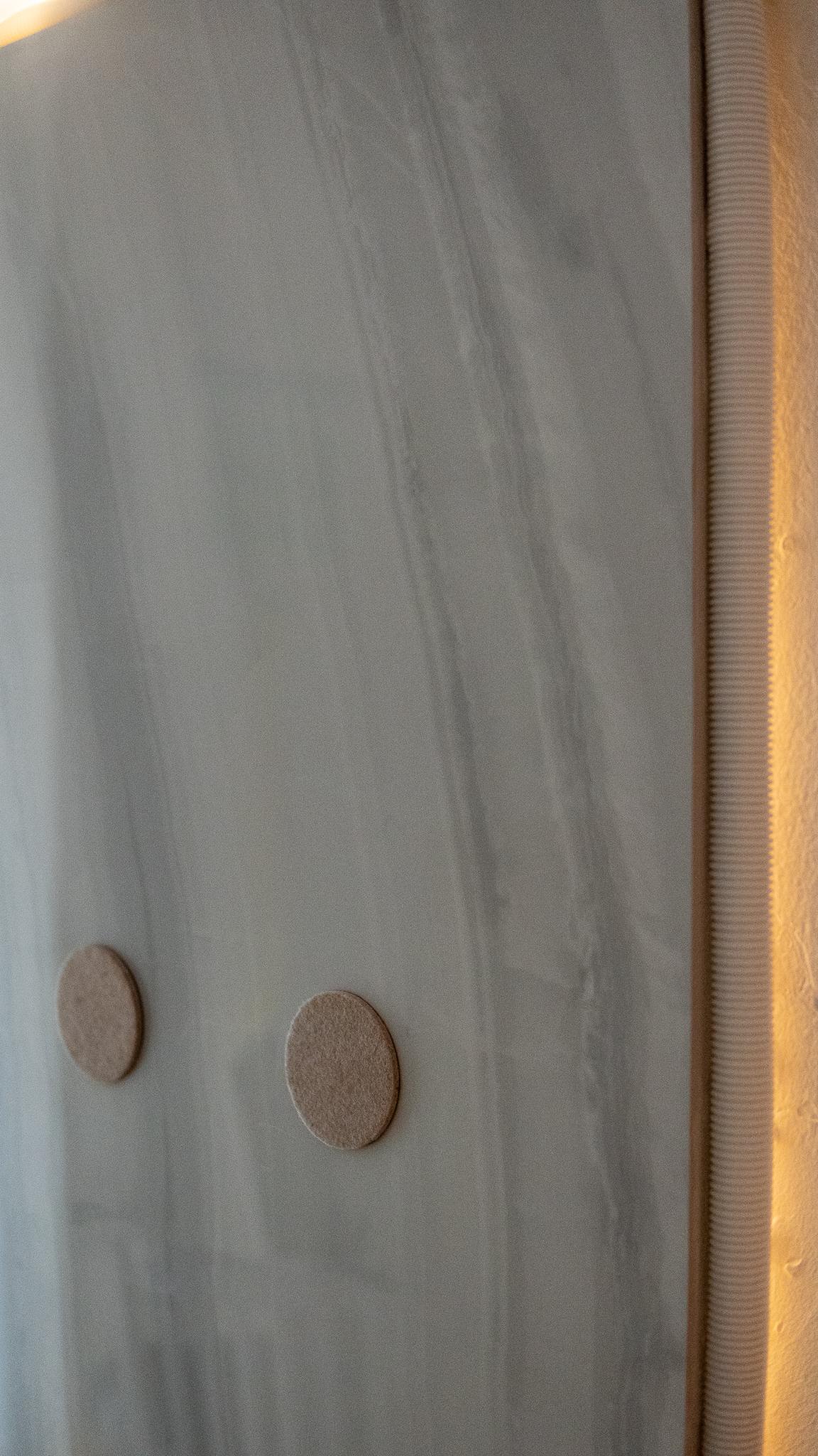 "Regina Viqueira, Installation documentation of ""Light Panel"", large format tile, light rope, furniture pads, cable organizer, MDF board, 28″ x 3″ x 49″"