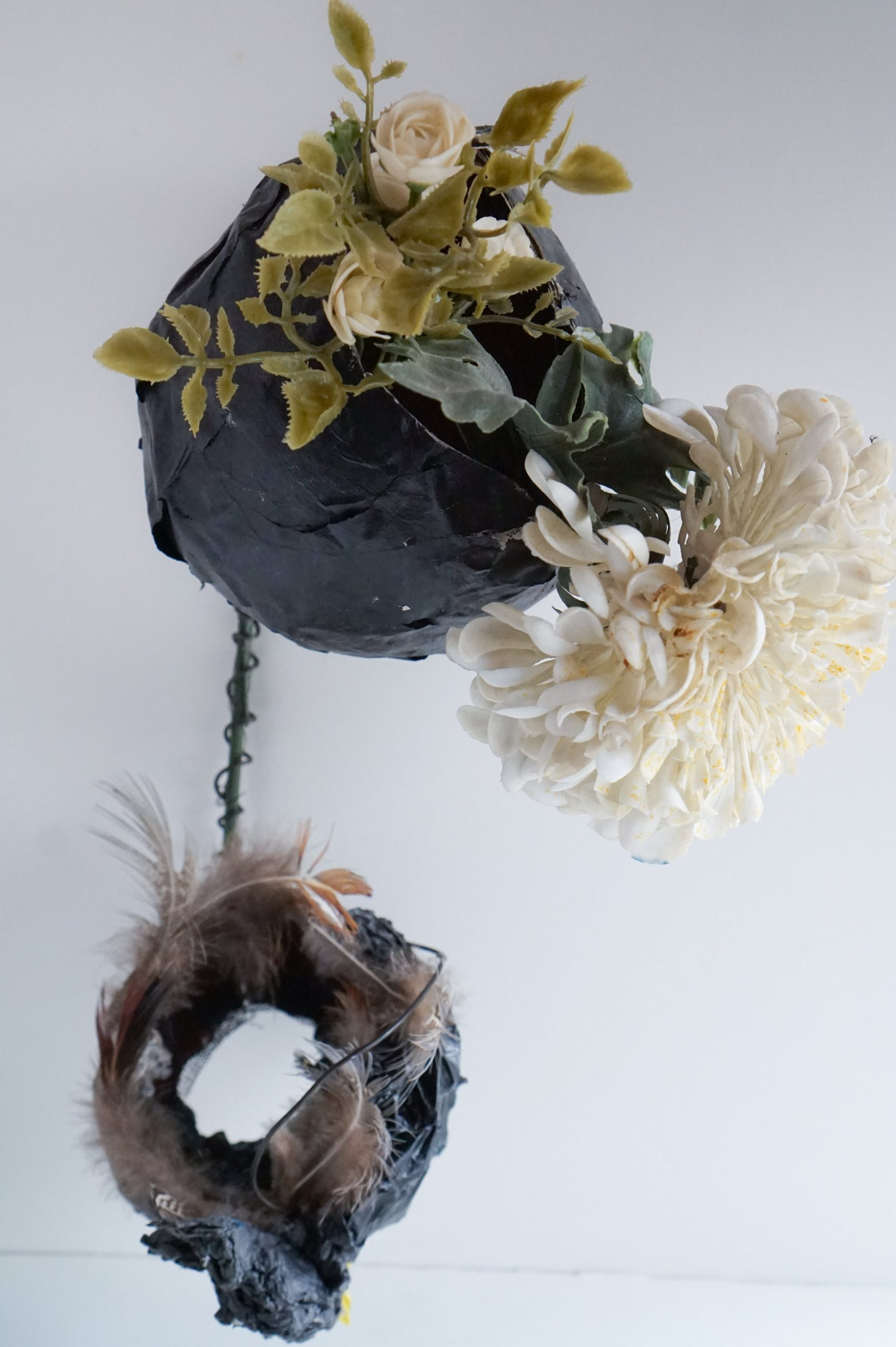 """Thingamabob #1. 2014. Paper, feathers, wire, glitter, pastel, paint, plastic flowers. 13"""" x 9"""" x 11"""