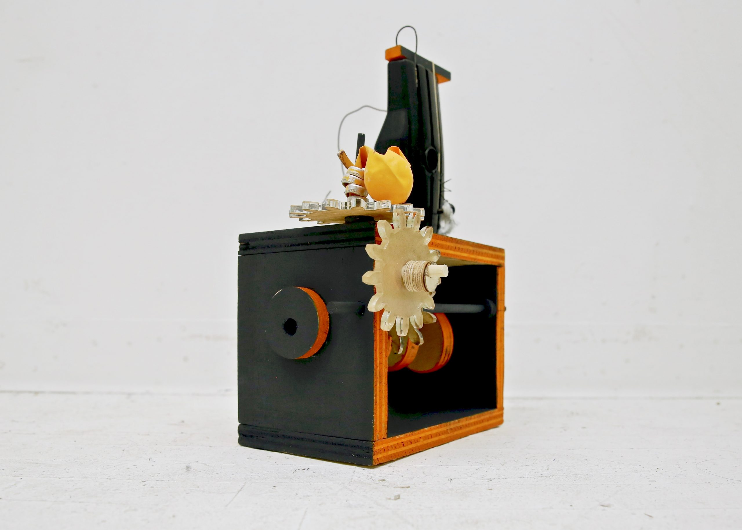 Spooky Sad Box, 2017, Acrylic gears, found wood, rubber bands, balloons, wire, paper pulp, swivel chair part, plastic thumb, plastic eye, plastic skeleton toy fragment, acrylic paint, wood glue, and brads, approx. 12