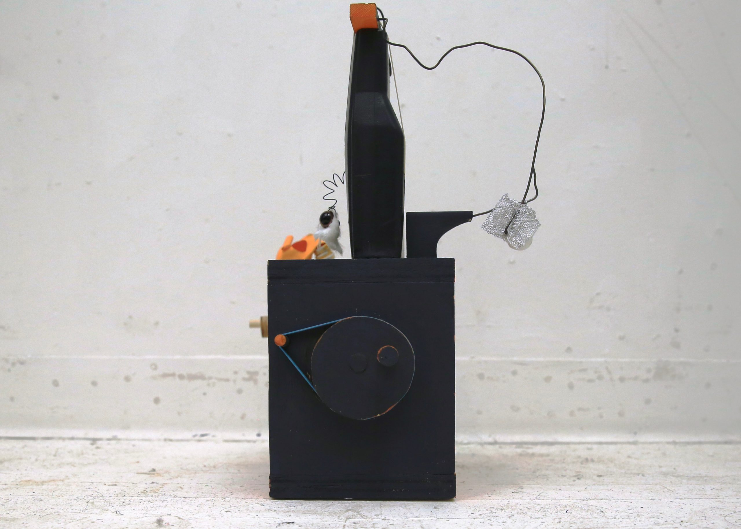 Spooky Sad Box (side), 2017, Acrylic gears, found wood, rubber bands, balloons, wire, paper pulp, swivel chair part, plastic thumb, plastic eye, plastic skeleton toy fragment, acrylic paint, wood glue, and brads, approx. 12